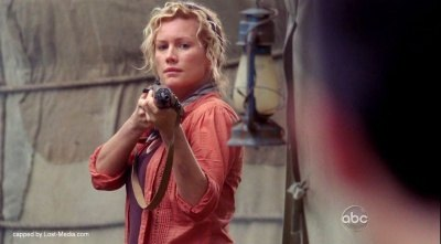 Ellie with gun in 5x14 The Variable