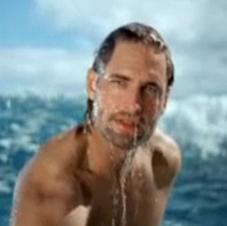 Josh Holloway, emerging from the ocean, in screenshot from TV commercial