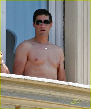Matthew Fox, without his shirt, on a balcony in Rome, July 2009